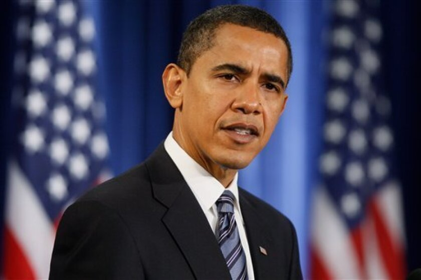 President-elect Barack Obama speaks about Illinois Gov. Rod Blagojevich, Thursday, Dec. 11, 2008, during a news conference in Chicago. (AP Photo/Charles Dharapak)