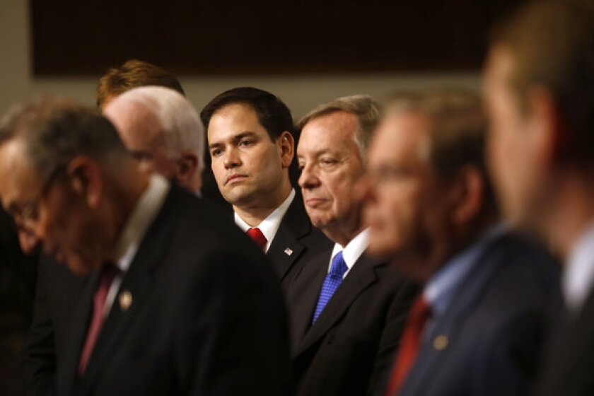 "Although passing an immigration reform bill isn't easy, polling shows that there's a consensus about what to do. Even among Republicans support for a ""path to citizenship"" is high if people here illegally meet strict requirements. Above: Sen. Marco Rubio (R-Fla.), center, and other members of the GOP meet the press on Capitol Hill to discuss immigration reform."