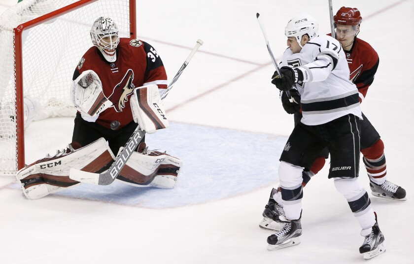 Coyotes goalie Louis Domingue makes a save on a shot as Kings forward Milan Lucic raises his stick in an attempt to redirect the puck during the third period of a game on Jan. 23.