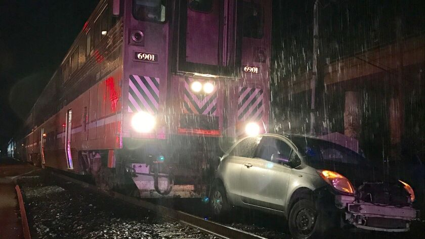 A train carrying 60 passengers struck a vehicle left on tracks in Ventura.