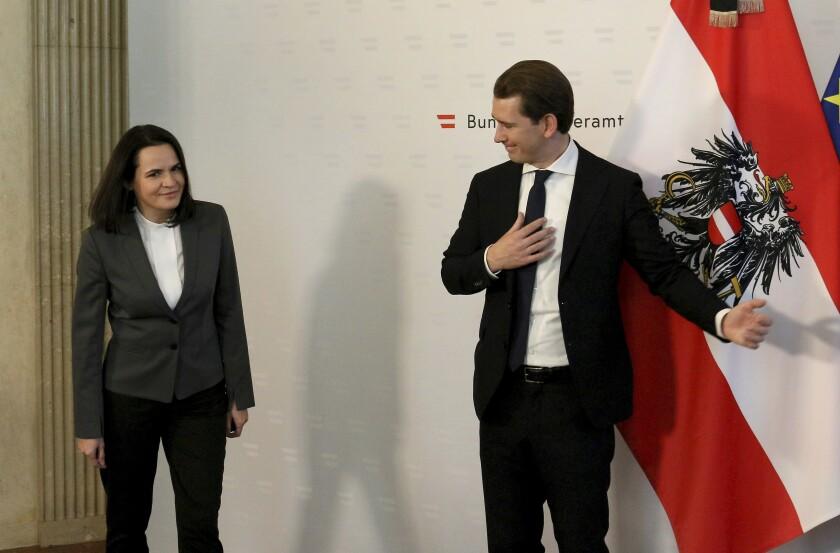 Austrian Chancellor Sebastian Kurz, right, welcomes Belarusian opposition leader Svetlana Tikhanovskaya before a meeting at the federal chancellery in Vienna, Austria, Thursday, Nov. 5, 2020. (AP Photo/Ronald Zak)