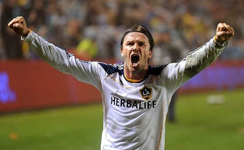 Galaxy midfielder David Beckham celebrates the team's MLS championship in 2011.