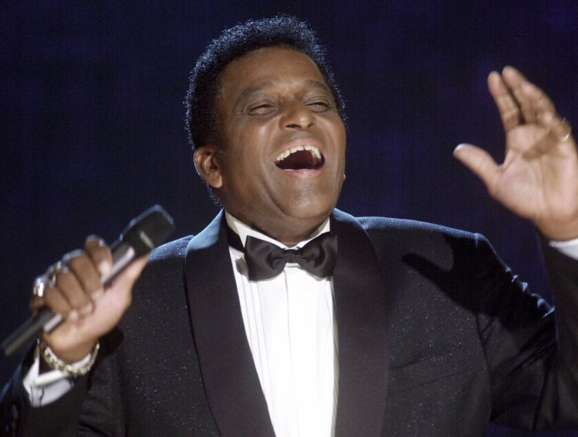 FILE - In this Oct. 4, 2000, file photo, Charlie Pride performs during his induction into the Country Music Hall of Fame at the Country Music Association Awards show at the Grand Ole Opry House in Nashville, Tenn. Pride, the son of sharecroppers in Mississippi and became one of country music's biggest stars and the first Black member of the Country Music Hall of Fame, has died at age 86. Pride died Saturday, Dec. 12, 2020, in Dallas of complications from Covid-19, according to Jeremy Westby of the public relations firm 2911 Media. (AP Photo/Charlie Neibergall, File)