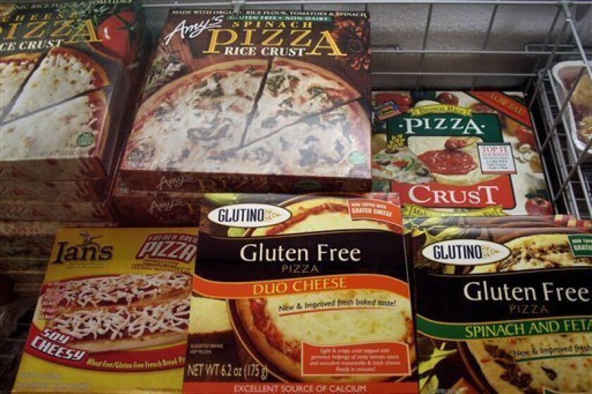 FILE - This Nov. 11, 2008, file photo, shows gluten-free frozen pizza, just one of hundreds of items at Gluten Free Trading Co. in Milwaukee. Schools, restaurants and anyone else serving food are more vulnerable to legal threats over food sensitivities after the Justice Department determined that s