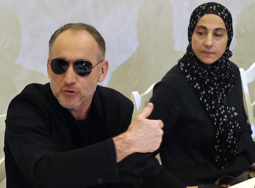 Anzor Tsarnaev and his wife, Zubeidat Tsarnaeva, the parents of the suspected Boston bombers, speak with reporters in Makhachkala, Dagestan, last week.