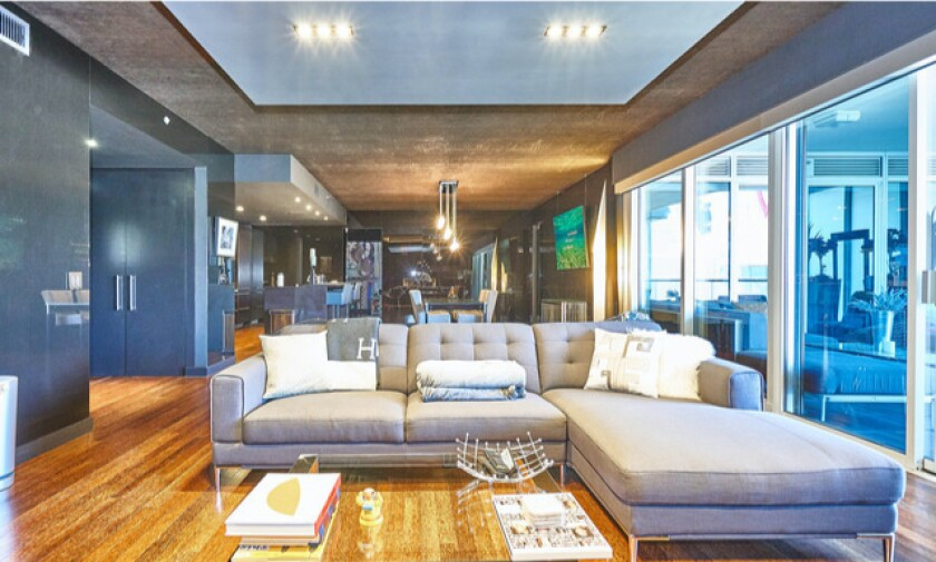 NBC exec George Cheeks lists Hollywood penthouse at a loss