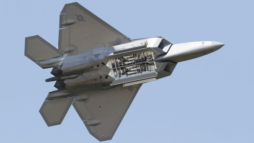 An Air Force F-22 Raptor displays its weapons bay as it's taken through maneuvers during a demonstration at Langley Air Force Base in Hampton, Va., on April 30, 2012.