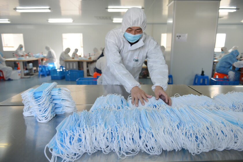 A factory in Nanjing, China, churns out masks to combat the coronavirus.