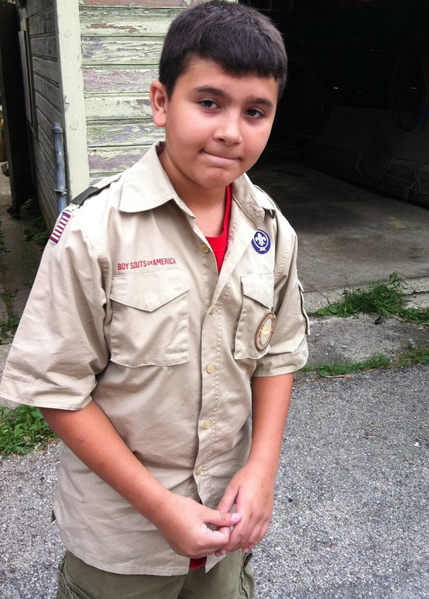 This July 16, 2011 photo provided by Jennifer Fite shows her son, David, 12, in Chicago before heading to Boy Scout camp in Michigan. David first learned about the Boy Scout's bans on openly gay scouts and leaders when he was at camp. He came home and told his mother he wanted to quit. She encourag
