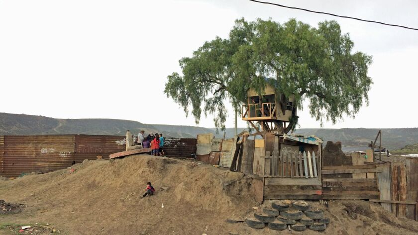 A view of the treehouse built by Japanese art collective Chim Pom on the Tijuana side of the U.S.-Mexico border wall.