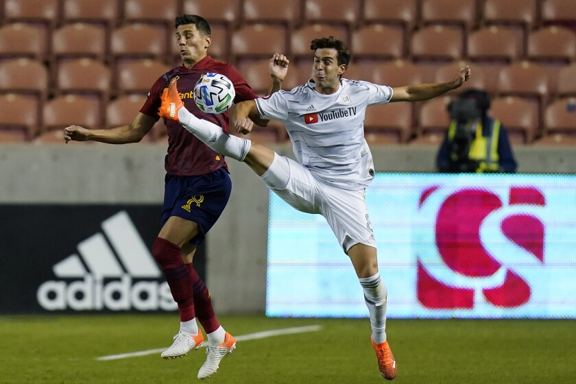Real Salt Lake midfielder Damir Kreilach defends against LAFC midfielder Francisco Ginella.