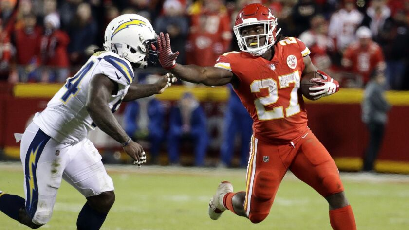 Kansas City Chiefs running back Kareem Hunt (27) stiff arms Chargers linebacker Melvin Ingram (54) during a game last season. The two teams will meet in Week 1.