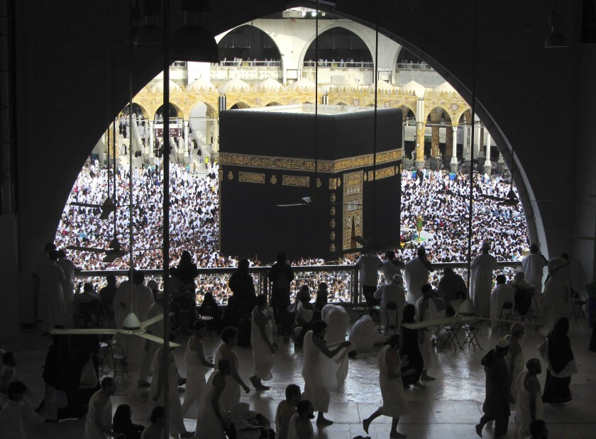 FILE - In this May 25, 2019 file photo, Muslim worshippers circumambulate the Kaaba, the cubic building at the Grand Mosque, during the minor pilgrimage, known as Umrah in the Muslim holy city of Mecca, Saudi Arabia. Authorities on Monday, Sept. 21, 2020, released new details on how it plans to gradually allow Muslims back to Islam's holiest site in Mecca to perform the smaller-year-round pilgrimage, which has been suspended for the past seven months due to the coronavirus (AP Photo/Amr Nabil, File)
