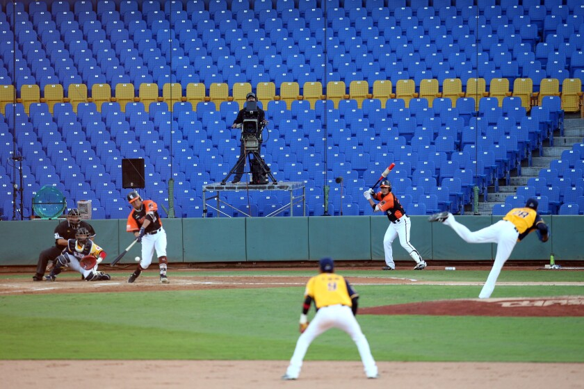 Former Seattle Mariners pitcher Ariel Miranda delivers for the Chinatrust Brothers against the Uni President Lions in Taiwan on April 12.