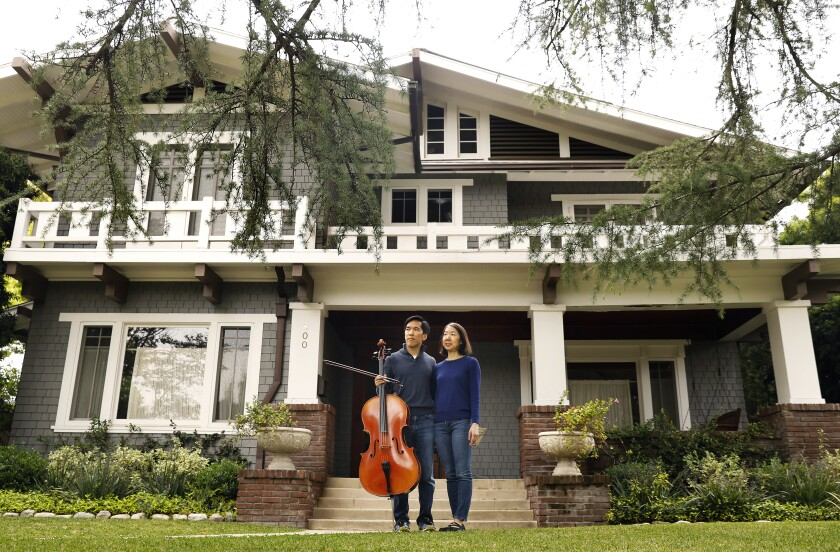Beong-Soo Kim and Bonnie Wongtrakool in front of their Pasadena home