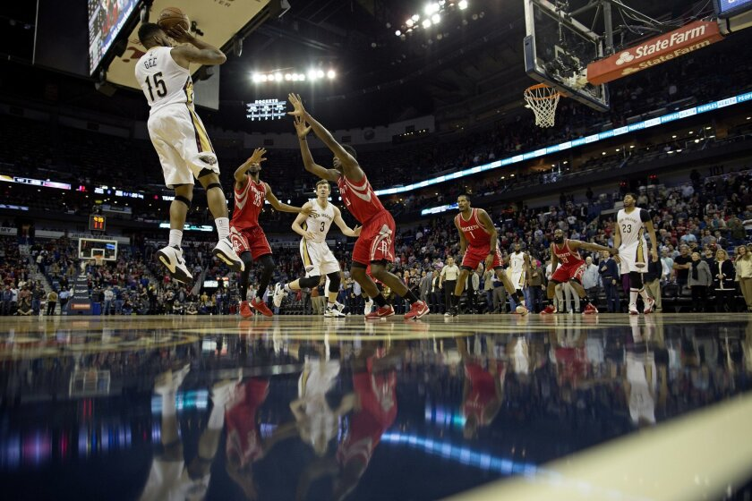 New Orleans Pelicans forward Alonzo Gee (15) attempts a shot in the first half of an NBA basketball game against the Houston Rockets in New Orleans, Monday, Jan. 25, 2016. (AP Photo/Max Becherer)