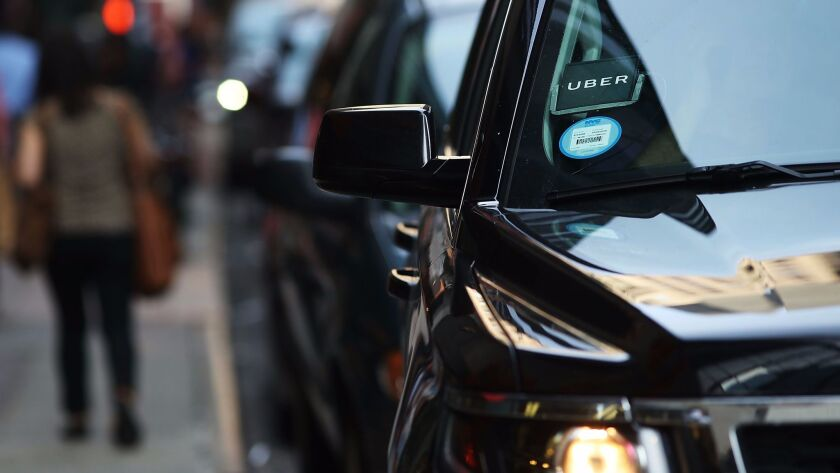 NEW YORK, NY - JUNE 14: An Uber SUV waits for a client in Manhattan a day after it was announced th