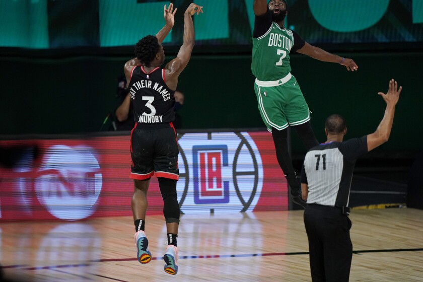 Toronto Raptors' OG Anunoby (3) releases a game-winning shot at the buzzer over Boston Celtics' Jaylen Brown (7) in the second half of an NBA conference semifinal playoff basketball game Thursday, Sept 3, 2020, in Lake Buena Vista Fla. (AP Photo/Mark J. Terrill)