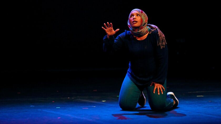 """Tamika Katon-Donegal performs one of the acts in """"E Pluribus Unum: Out of Many, One,"""" presented by Artists Rise Up Los Angeles at the El Portal Theatre in North Hollywood."""