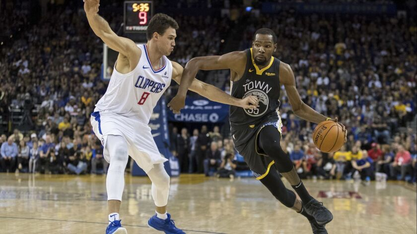 Golden State Warriors forward Kevin Durant (35) dribbles as Los Angeles Clippers forward Danilo Gall