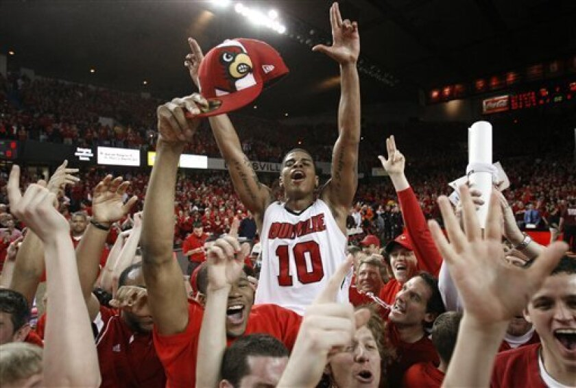 Louisville's Edgar Sosa is carried on the shoulders of fans after his team defeated No. 1 Syracuse 78-68 in an NCAA college basketball game in Louisville, Ky., Saturday, March 6, 2010. (AP Photo/Ed Reinke)
