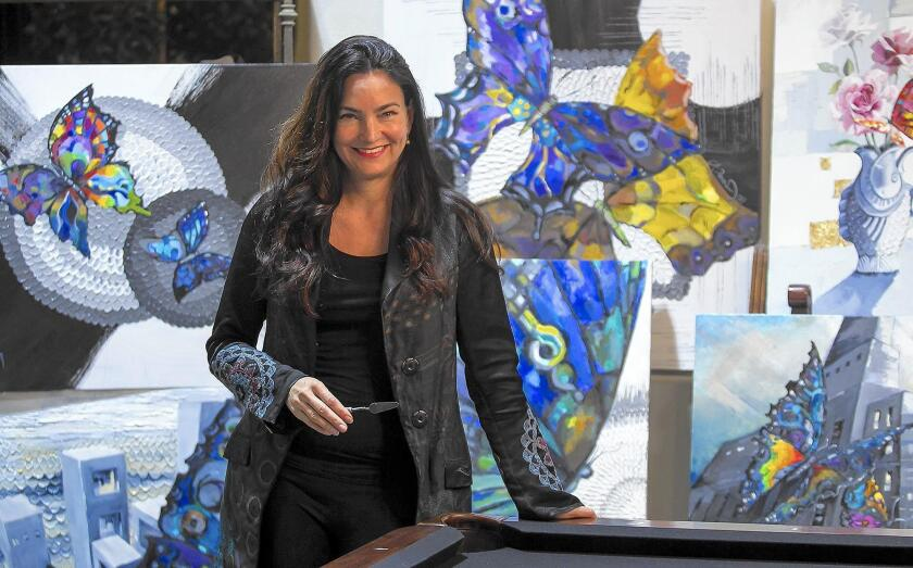 """Andrea Tarman is an artist who usesoil paint and gel to create a """"popping of the paint"""" effect."""