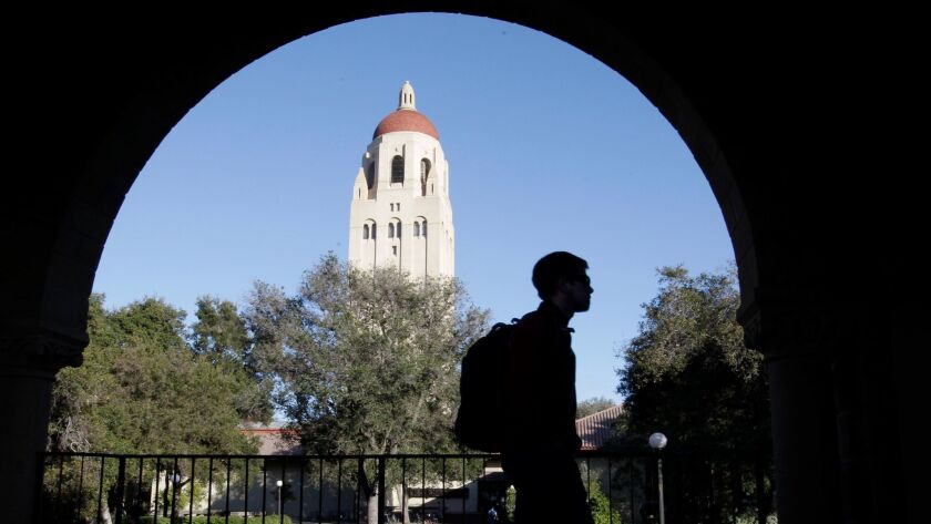 FILE - In this Feb. 15, 2012, file photo, a Stanford University student walks in front of Hoover Tow