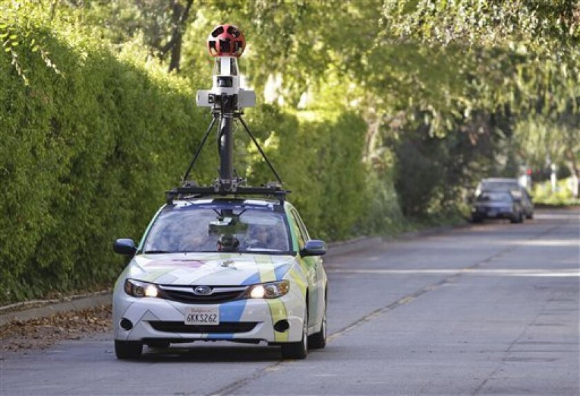 "FILE - In this Oct. 27, 2010 file photo, an employee drives a Google vehicle around Palo Alto, Calif., streets to shoot ""Street Views"". Israeli officials announced Sunday, Aug. 21, 2011, they have given Google a green light to photograph its streets and cities, convinced the Internet giant's Street"