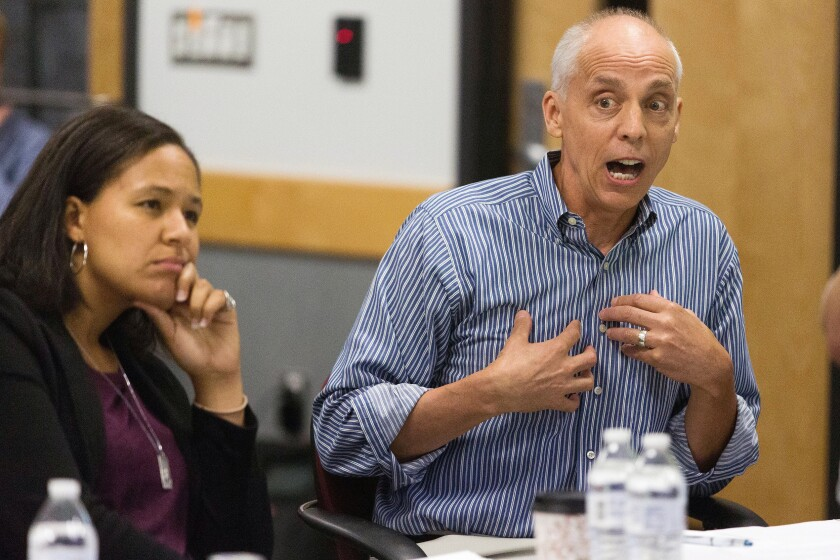 FILE - In this Thursday, July 28, 2016 file photo, Kalamazoo City Commissioner Shannon Sykes, left, listens as then City Commissioner David Anderson speaks during a Kalamazoo City Commissioner meeting at at Kalamazoo Metro Transit in Kalamazoo, Mich. It began with a highly unusual offer from two business executives — who both have billions in wealth — to bankroll a distressed city government. Five years later, the marriage of government and philanthropy born of that $70 million gift looks as though it will last forever. Kalamazoo, Michigan, officials gathered on the steps of their nearly century-old, Art Deco city hall on Wednesday, July 28, 2021 to announce an anonymous commitment of $400 million to an endowment established in 2017 to spin off annual revenues for the city indefinitely. It began with a highly unusual offer from two business executives — who both have billions in wealth — to bankroll a distressed city government. Five years later, the marriage of government and philanthropy born of that $70 million gift looks as though it will last forever. Kalamazoo, Michigan, officials gathered on the steps of their nearly century-old, Art Deco city hall on Wednesday to announce an anonymous commitment of $400 million to an endowment established in 2017 to spin off annual revenues for the city indefinitely. The Kalamazoo Foundation for Excellence now holds close to its $500 million goal, according to officials, and is expected to generate about $25 million a year. (Bryan Bennett/Kalamazoo Gazette via AP, File)
