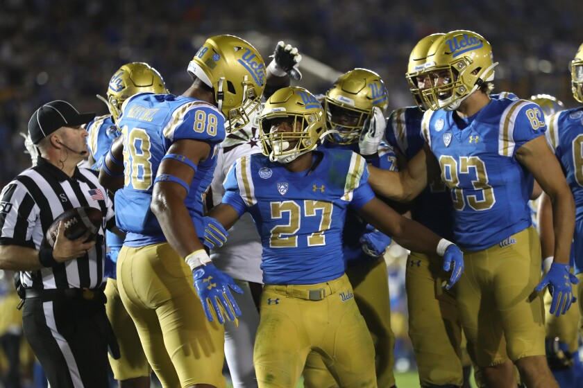 UCLA players celebrate after scoring in the second half against Arizona State on Saturday at the Rose Bowl.