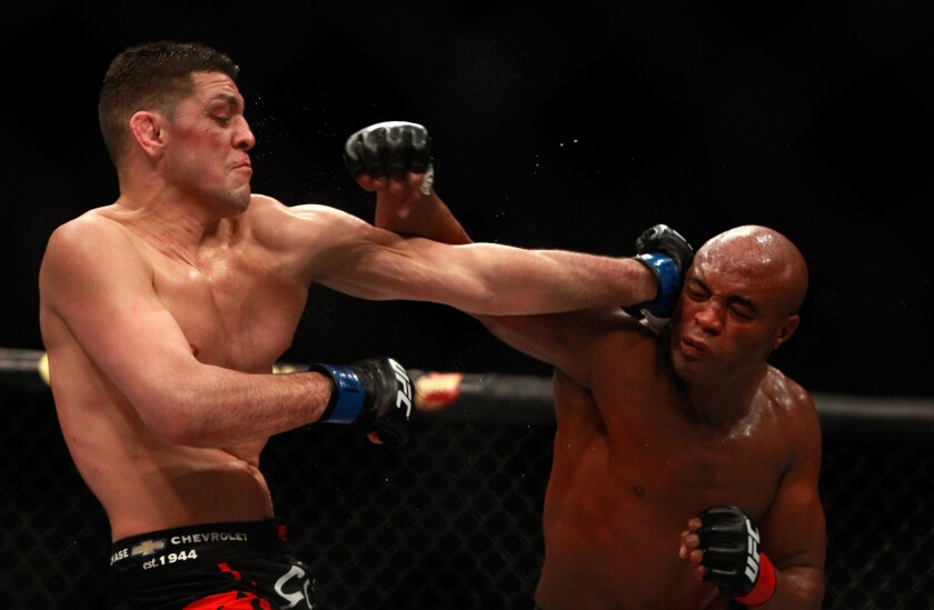 Nick Diaz, left, and Anderson Silva trade punches in their middleweight bout at the MGM Grand Garden Arena in Las Vegas.