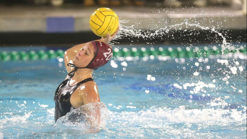 Laguna's Tea Poljak takes a long shot during Surf League girls' water polo against Corona del Mar ga