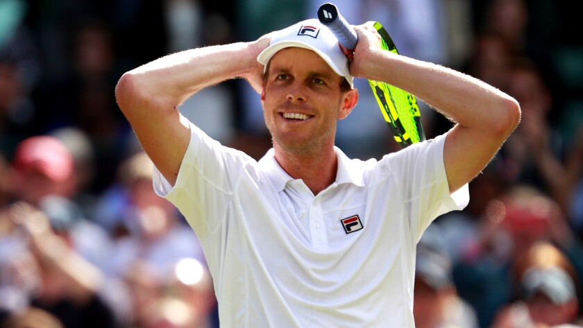 Sam Querrey reacts after defeating Novak Djokovic in the third round at Wimbledon in 2016.