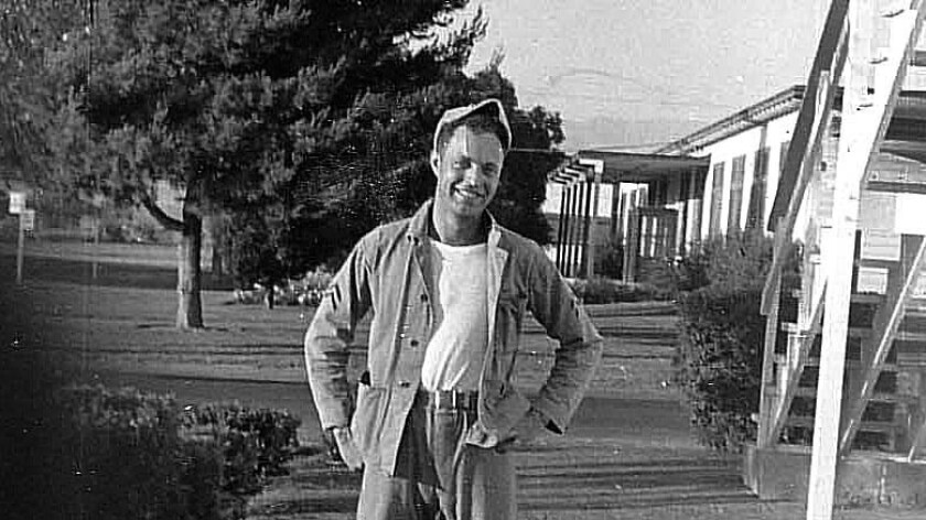 Ray Alkofer poses outside his barracks at the El Toro Marine Base in 1952.