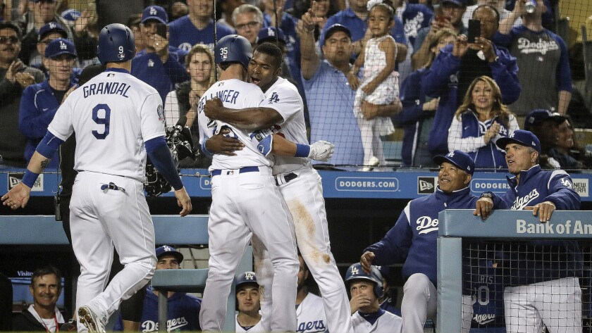 LOS ANGELES, CA, SUNDAY, APRIL 1, 2018 - Yasiel Puig embraces Dodgers teammate Cody Bellinger after