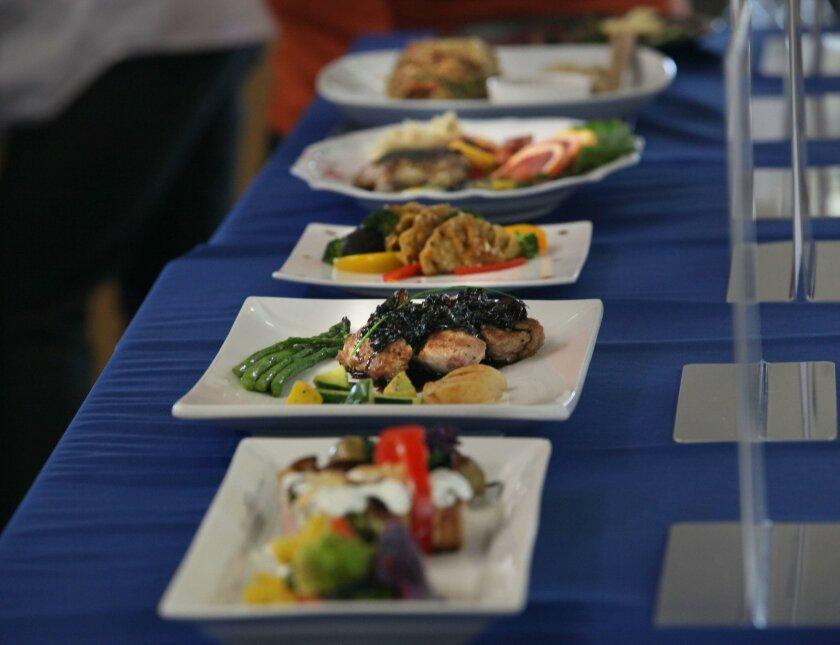 Escondido, CA. February 23, 2016 |   North County high school students showed off their culinary skills Tuesday during a district wide competition held at the Orange Glen High kitchens. Student teams had to create two plates of their meal: one for display, and one for judges to taste. The judges we