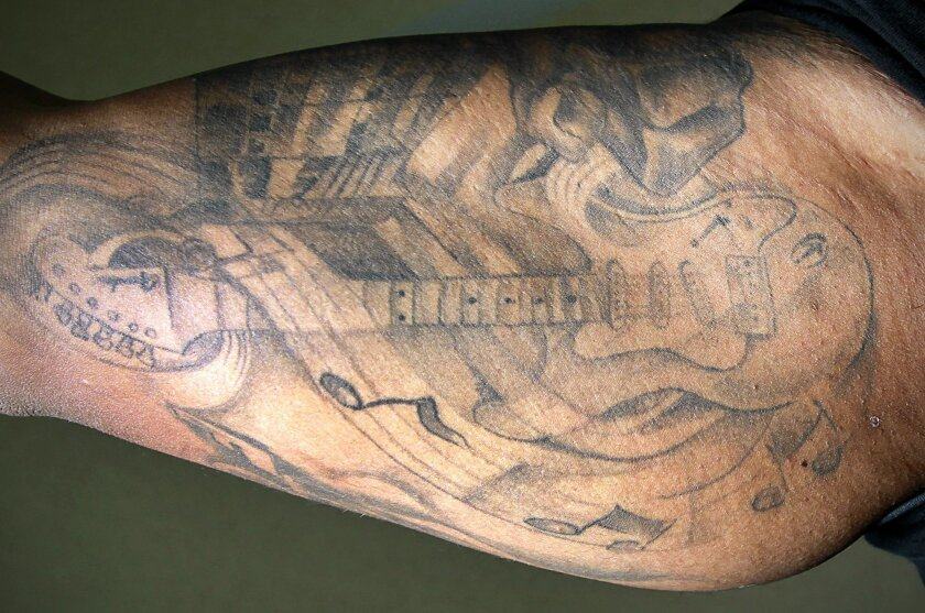 One of San Diego Chargers offensive lineman Joe Barksdale's tattoos is a Fender Stratocaster guitar like the one he played in his free time at the hotel near Chargers Park in Murphy Canyon where he stayed during minicamp.