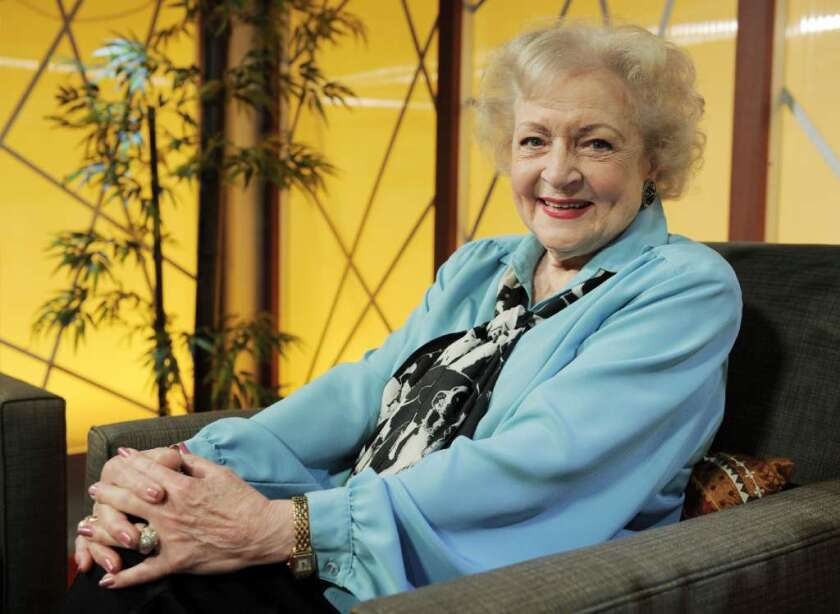 Betty White wearing a blue blouse