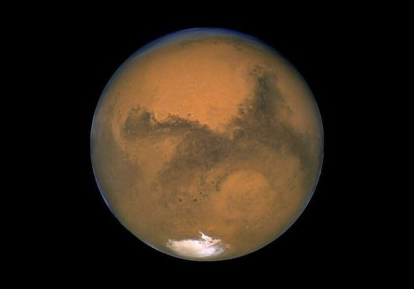 Astronauts could survive the elevated radiation levels on the surface of Mars, according to a NASA expert.