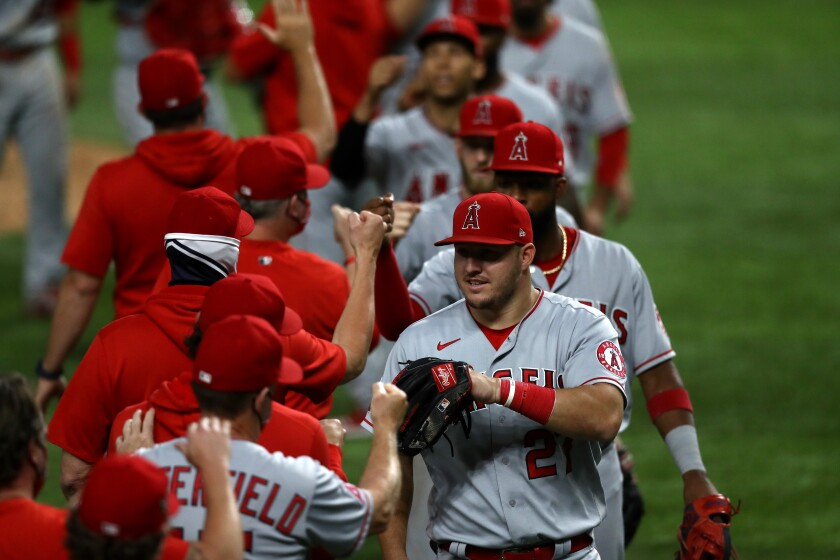 ARLINGTON, TEXAS - SEPTEMBER 10: Mike Trout #27 of the Los Angeles Angels celebrates a 6-2 win against the Texas Rangers at Globe Life Field on September 10, 2020 in Arlington, Texas. (Photo by Ronald Martinez/Getty Images)