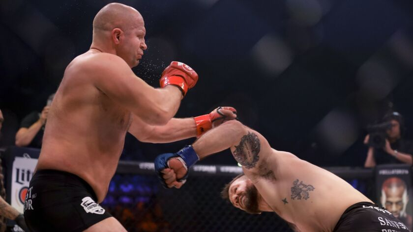 Ryan Bader, right, knocks out Fedora Emelianenko after flooring him with a left to the face during their bout at Bellator 214.