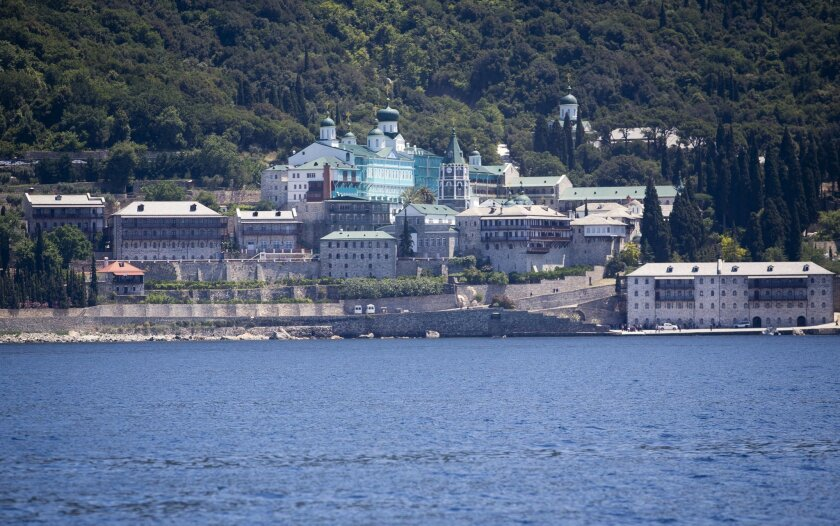 A view from the sea of the Russian monastery St. Panteleimon in Karyes, on Mount Athos, Greece, Friday, May 27, 2016. Russia's president is due in financially struggling Greece Friday for a state visit that will include a trip to a 1,000-year-old, all-male Orthodox Christian sanctuary in the north