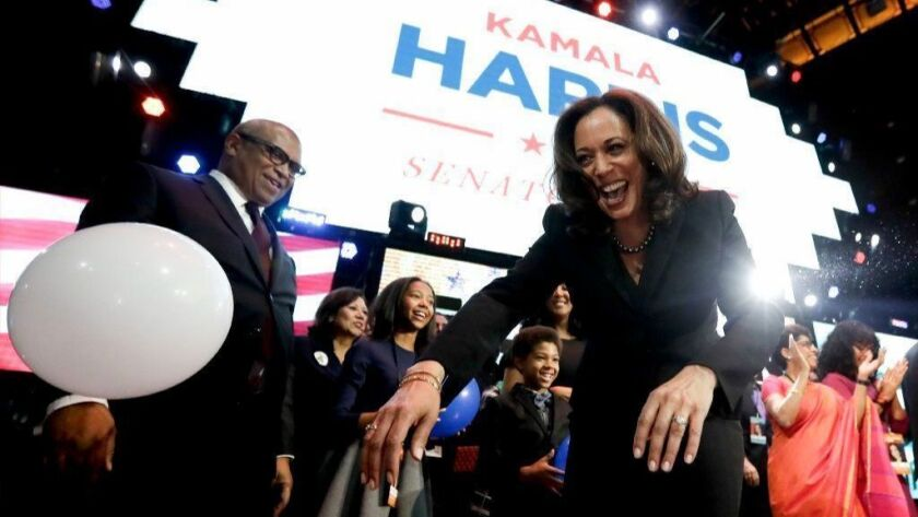 Then-California Atty. Gen. Kamala Harris greets supporters at an election-night rally for her Senate candidacy on Nov. 9, 2016.