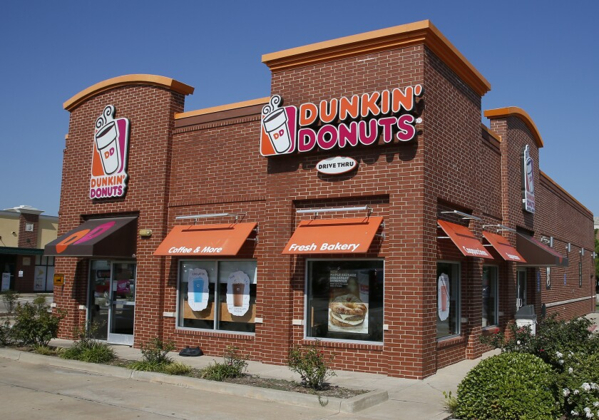 """Dunkin' Donuts is thinking about dumping """"Donuts"""" from its name. A new location in Pasadena, Calif., will be called simply Dunkin', a move that parent company Dunkin' Brands Inc. calls a test. The Canton, Mass.-based company says a few other stores will get the one-name treatment too."""