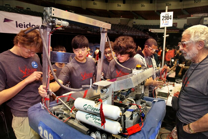 First Robotics Competition Game at the Valley View Casino Center (sports arena)- The team from La Jolla High works on their robot.