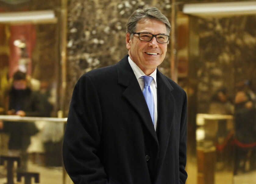 Former Texas Gov. Rick Perry smiles as he leaves Trump Tower in New York on Dec. 12, 2016.