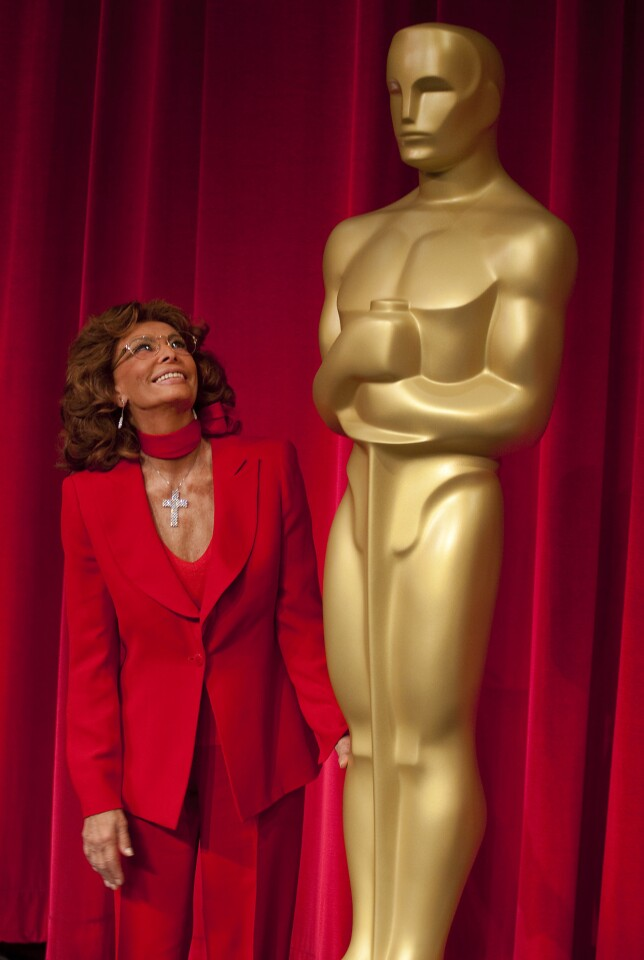 Sophia Loren's life is a rags-to-riches story. Born Sofia Scicolone in Rome in 1934, she grew up fatherless in the Pozzuoli slums during World War II. By the 1950s, she was playing bit parts in Italian films under the name Sofia Lazzaro - a reference to Lazarus, because people joked that her beauty could raise the dead. By the 1960s, she was an international movie star, with an Oscar under her belt. She remains an icon in the worlds of film and fashion and was honored by the Academy of Motion Picture Arts and Sciences on May 4, 2011.