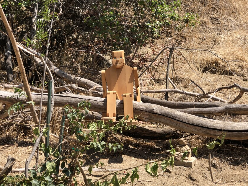 Just beyond Wattles Mansion is a little-trafficked canyon that has funky works of art strewn among the trails, including a wooden figure with marble eyes and a plaque with a smiling Buddha.