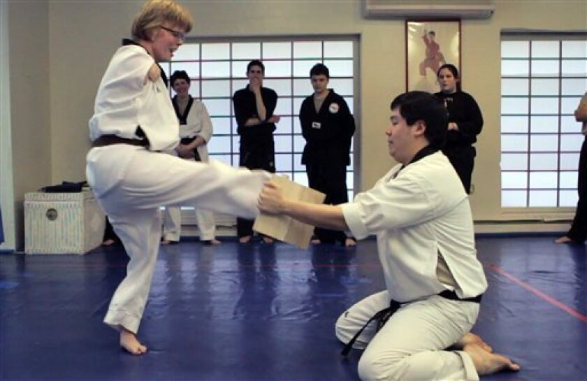 Mass  woman with no arms preparing for black belt - The San