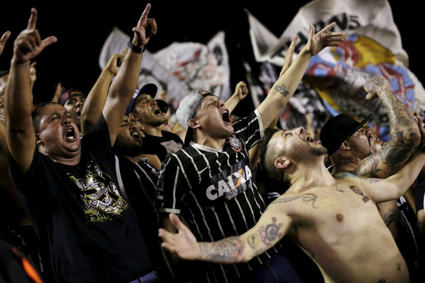 Fans celebrate as Corinthians win the Brazil Serie A soccer championship title, following their match with Vasco, in Rio de Janeiro, November 19, 2015. Corinthians were crowned Brazilian champions on Thursday after a 1-1 draw with Vasco da Gama, coupled with Atletico Mineiro's 4-2 defeat at Sao Paulo, game them an unassailable 12-point lead with three games remaining. REUTERS/Ueslei Marcelino ** Usable by SD ONLY **